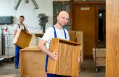 picture of dungarees  - two worker in blue dungarees in a carpenter - JPG