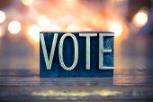 image of voting  - The word VOTE written in vintage metal letterpress type on a soft backlit background - JPG