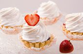 image of cake stand  - cake with white cream and fresh strawberries on a stand - JPG