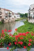 foto of vicenza  - Flowered iron balcony of Saint Paul bridge in Vicenza with a view of Retrone river and Saint Michele bridge in the background - JPG