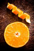 image of mandarin orange  - Orange mandarin tangerine half top view and peel - JPG