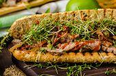 foto of cheesesteak  - Steak sandwich with herbs lime and microgreens with little bit kick of hot sriracha souce - JPG