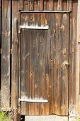 stock photo of wooden door  - Ramshackle wooden brown door to a shed - JPG