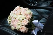 stock photo of bouquet  - bridal bouquet in the car - JPG