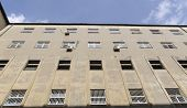 picture of prison uniform  - Prison walls surrounds walking yard in prison - JPG