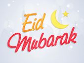 image of eid festival celebration  - Shiny text Eid Mubarak with golden crescent moon and star on mosque silhouetted background for Islamic famous holy festival - JPG