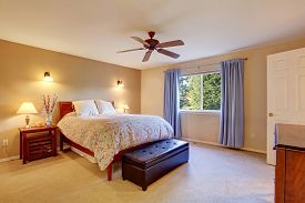 image of master bedroom  - Beautiful master bedroom with carpet and floral bedding - JPG