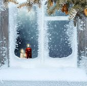 Frosted window with Christmas decoration.Merry Christmas and happy New Year greeting card with copy- poster