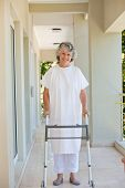 picture of zimmer frame  - Senior woman with her zimmer frame - JPG