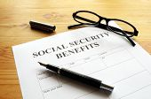 foto of social-security  - social security benefits form showing financial concept in office - JPG