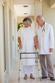 stock photo of zimmer frame  - Doctor walking with his patient - JPG