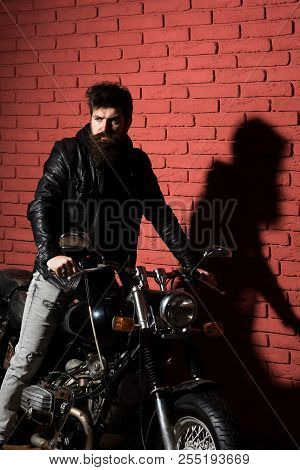 poster of Motor Salon. Bearded Man With Bike In Motor Salon. Motor Salon Services. Man In Motor Salon Or Repai