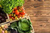 Variety Of Healthy Fresh Vegetables In Boxes Displayed On A Wooden Table Wooden Table At An Organic  poster