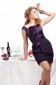 stock photo of nea  - Portrait of beutiful woman standing nea table in restaurant - JPG