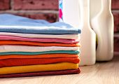 Clean, Colorful, Folded Clothes. Means For Washing Clothes. poster