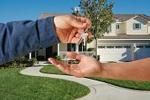 pic of real-estate agent  - Handing Over the Keys to A New Home - JPG