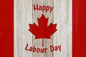Happy Labour Day For Canda On Weathered Wood With A Flag Design poster