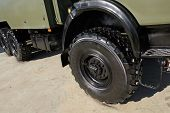 Military Vehicle Truck Wheels On Hub With Black Shine Tires. New Clean Off Road Transport Truck All  poster