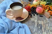 Flat Lay Of Composed Cup With Black Coffee On Wood Table With Ripe Berries Of Rowan And Dark Foliage poster