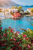Beautiful View Of Assos Village With Vivid Colorful Houses Near Blue Turquoise Colored And Transpare poster