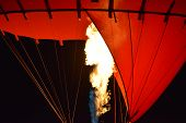 Close-up Of A Part Of Red Hot Air Balloon Burner Flame Glowing At Night, Burner With A Extreme Hot F poster