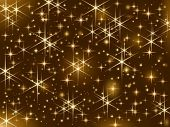 stock photo of sparkles  - Dark brown background with sparkling golden stars - JPG