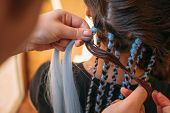 Hairdresser Weaves Braids With Kanekalon Material To Young Girl Head, Making Creative Hairstyle With poster