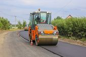 Work On Laying Of An Asphalt Paving By Means Of Heavy Machinery poster