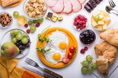 Woman Cooking Breakfast. Healthy Breakfast Ingredients, Food Frame. Granola, Egg, Dates,nuts, Fruits poster