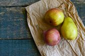 Tasty Ripy Juicy Colorful Juicy Pears On Wooden Background poster