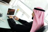 Modern arabic businessman on office working on laptop