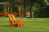 Pair Of Muskoka Chairs On Lawn