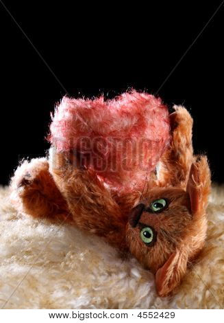 poster of Unique Cat Holding Fluffy Heart In His Paws On Fur And Black Backgrounds