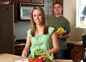 Young Couple Cooking poster