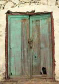 Old damaged wooden doors