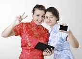 picture of gizmo  - Two Caucasian young women are standing and smiling - JPG