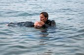 stock photo of cpr  - Rescue diver giving CPR to a diving casualty - JPG