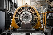stock photo of dynamo  - an electric power generator dynamo detail component - JPG