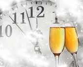 Champagne glasses and clock