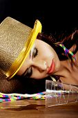 stock photo of bolero  - Young beautiful drunk woman sleeping on a table after celebrating new years eve - JPG