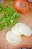 fresh onions and parsley closeup on  wooden bord
