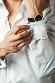 stock photo of wrist  - Sexy man buttons cuff - JPG