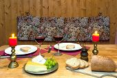image of chalet  - Intimate dinner table setting with candles and wine served in a romantic mountain chalet in the Alps - JPG