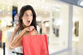 picture of mall  - Woman in shopping center with bags - JPG