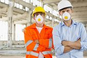 picture of headgear  - Portrait of confident male construction workers in protective workwear at site - JPG