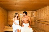 image of sauna woman  - Couple having a sauna bath in a steam room - JPG