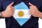 pic of south american flag  - Young sport fan opening his shirt and showing the flag his country argentina argentinian flag - JPG