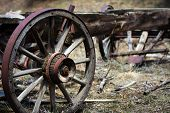 foto of wagon  - An old abandoned wagon frame and wheels in the mountains of Colorado - JPG