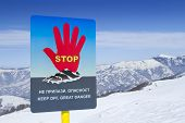 stock photo of avalanche  - Avalanches warning sign in ski resort - JPG