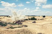 picture of raid  - Large explosion near the car with soldiers in the desert - JPG